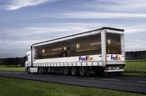 Fedex truck with UPS trucks