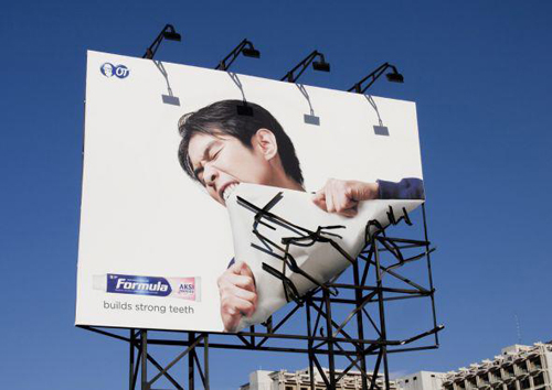 strong teeth breaking billboard